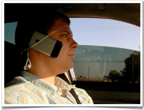 of cradling my iPhone for hands-free conversations while driving.